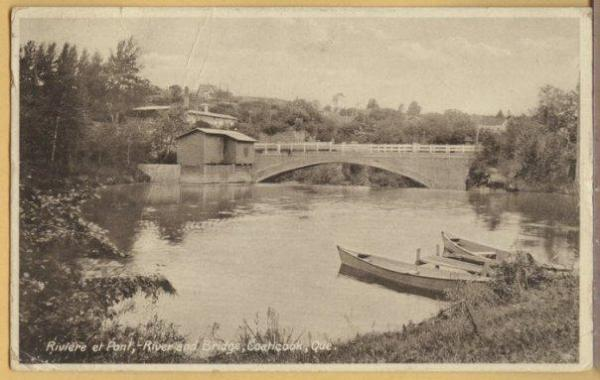 View of the Coaticook River at the exit to the bridge of St Paul. Note the moored boats which were also used for the ride and transportation.