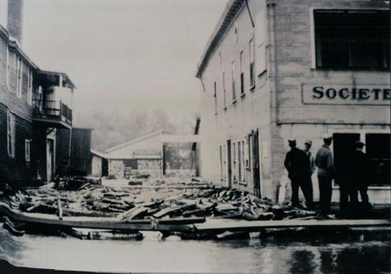 Wood floating on the water near the Agricultural Cooperative of Coaticook in the flood of June 1943