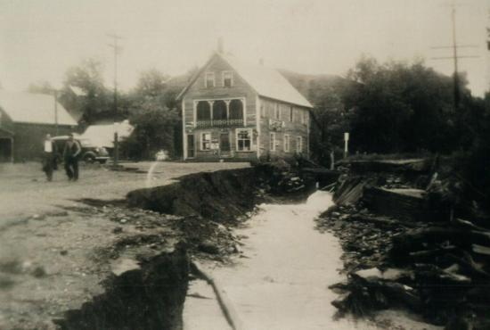 Flooding on the Child street in front of the store during the flood in June 1943