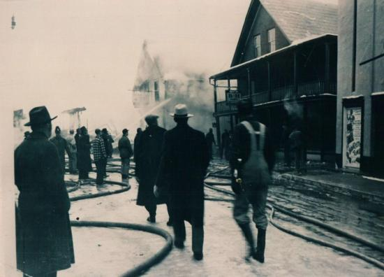 Burning buildings on the street Child January 16, 1949