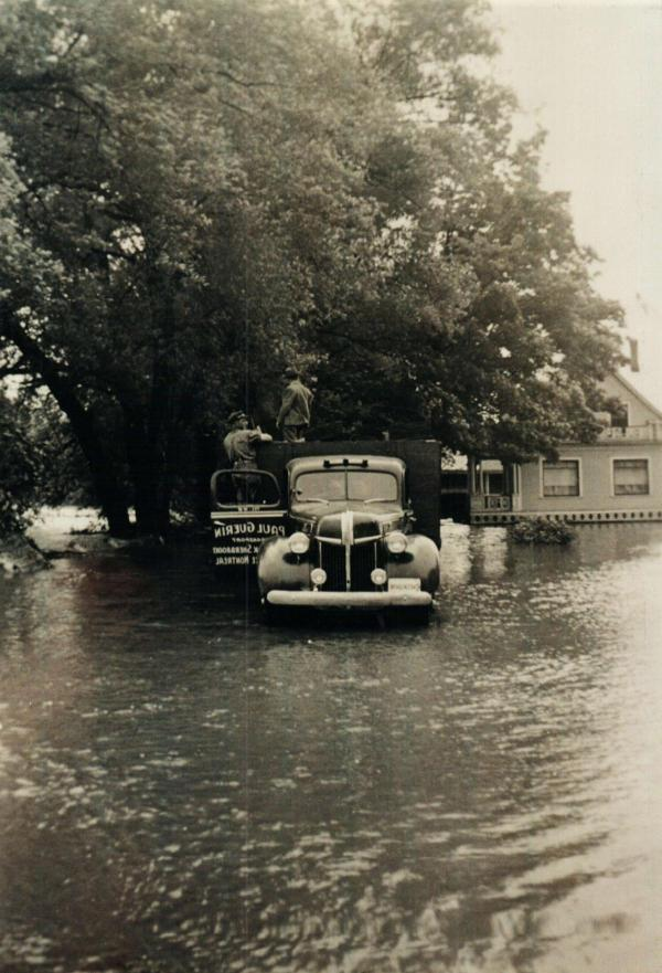 Truck in the front yard of Mr. Alfred Marcoux during the flood of 15 and 16 June 1943