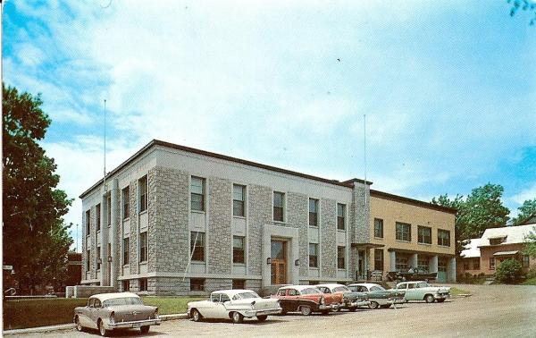 Postcard from the Town Hall built in 1954 in Coaticook right side view.